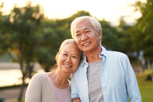 senior couple outdoors and smiling