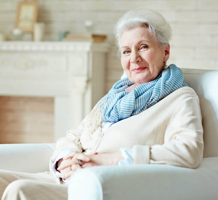 Senior woman on chair with blue scarf